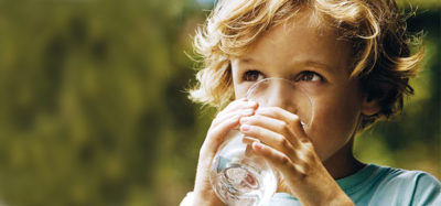clean well water - child drinking